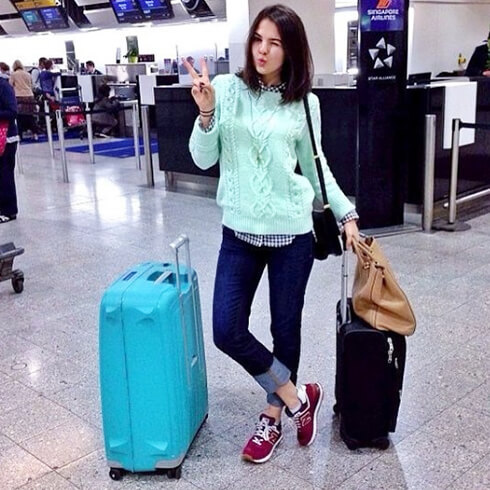 Priscila Betancort waiting for her flight with her Yellow S'Cure...